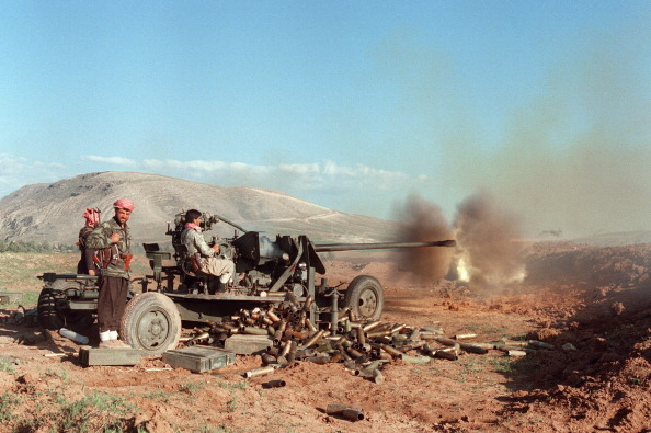 Kurdish peshmerga rebels shoots with an