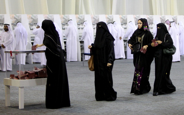 Emirati women cast their votes in a ball
