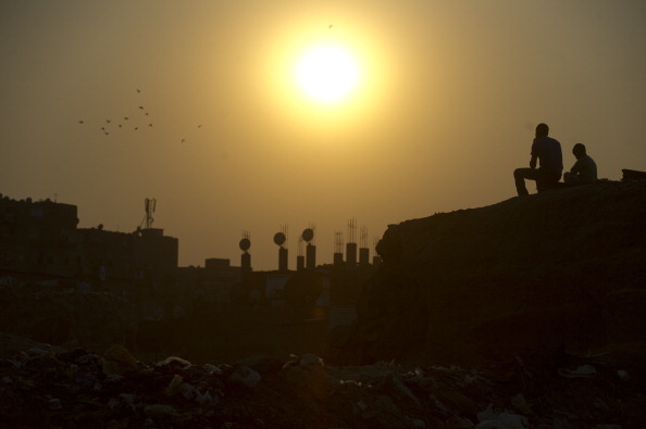CAIRO, EGYPT - OCTOBER 5: Sunset over an informal housing site stretching along the Muqattam cliffs in the Manshiet Nasser slums October 5, 2011 on eastern outskirts of Cairo, Egypt. The slum sits near the bulldozed site of a rock slide in 2008 which killed over 30 people. Along with the threat of another rock slide, residents live without basic public services such as water supply and waste management. (Photo by Ann Hermes/The Christian Science Monitor via Getty Images)