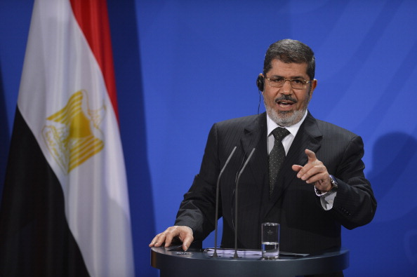 Egyptian President Mohamed Morsi gives a press conference following a meeting with the German Chancellor at the Chancellery in Berlin on January 30, 2013. Morsi's visit will focus on bilateral cooperation as well as the situation in Egypt, where almost a week of violence has left more than 50 people dead, Egypt's official news agency MENA said. AFP PHOTO / ODD ANDERSEN (Photo credit should read ODD ANDERSEN/AFP/Getty Images)