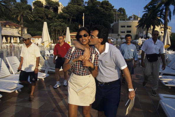 Rendezvous With Prince Al-Waleed Of Saudi Arabia In The French Rivieira. Sur la Côte d'Azur, à Monte -Carlo, le prince AL -WALEED BEN TALAL D'ARABIE SAOUDITE, marchant sur la terrasse d'un hôtel, embrassant sa fille la princesse REEM. . (Photo by Bruno Bachelet/Paris Match via Getty Images)