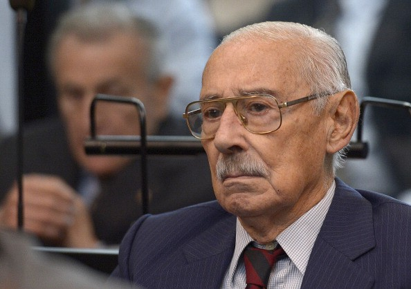 "Former Argentine dictator and general, Rafael Videla, is seen during his trial to investigate the crimes committed during Operation Condor, a campaign established by Argentina, Chile, Paraguay, Brazil, Bolivia and Uruguay's dictatorships to quash the opposition during the 1970s, in Buenos Aires on March 5, 2013. Argentina's junta, which Videla led from 1976-81, is held responsible for the disappearance of up to 30,000 people during the so-called ""Dirty War"" against political opponents. Videla, Bignone and Menendez are among the 26 defendants. Jorge Rafael Videla passed away in Argentina on May 17, 2013 at the age of 87.   AFP PHOTO / Juan Mabromata        (Photo credit should read JUAN MABROMATA/AFP/Getty Images)"