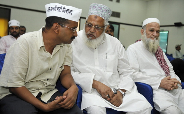 NEW DELHI, INDIA - AUGUST 29: Aam Aadmi Party leader Arvind Kejriwal interacting with Muslim leader during program Muslims and AAP to induct members from minority community in the party on August 29, 2013 in New Delhi, India. A group of Muslims, including Aligarh Muslim University alumni Irfanullah Khan and social activist Firoz Bakht Ahmed joined AAP . With less than three months for the assembly elections in Delhi, AAP is trying hard to tap various groups. (Photo By Sonu Mehta/Hindustan Times via Getty Images)