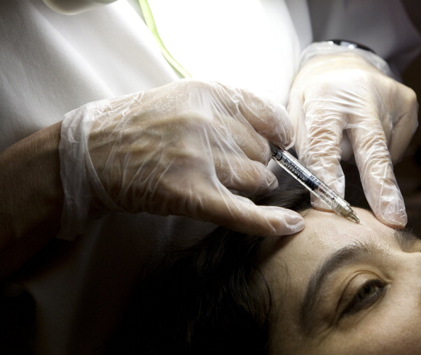 Botox Treatment, Woman, Center for esthetic medicine, Paris, Injecting botulinum toxin to fill in forehead wrinkles. (Photo By BSIP/UIG via Getty Images)