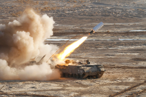 An Israel Defense Force Combat Engineers Puma armored personnel carrier launches a mine clearing line charge.