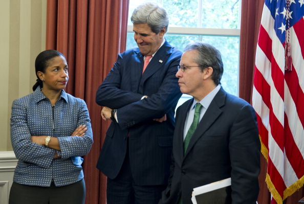 National Security Adviser Susan Rice (L), Secretary of State John Kerry (C) and Director of the National Economic Council Gene Sperling (R), attend a meeting between US President Barack Obama and Italian Prime Minister Enrico Letta in the Oval Office of the White House in Washington, DC, October 17, 2013. AFP PHOTO / Saul LOEB (Photo credit should read SAUL LOEB/AFP/Getty Images)