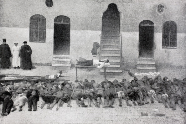 Bodies Of Armenians Massacred On February 28, 1919 In Aleppo, Syria, Laid Out In Front Of Armenian Relief Hospital. From L'illustration, 1919. (Photo by: Universal History Archive/UIG via Getty Images)