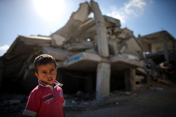 Mounds of rubble and destroyed buildings continue to scar the landscape of Gaza on June 10, 2015, Gaza City, Gaza. The devastation across Gaza can still be seen nearly one year on from the 2014 conflict between Israel and Palestinian militants. United Nations official figures said that the 50 day war left at least 2,189 Palestinians dead, including more than 1,486 civilians, and 11,000 injured. 67 Israeli soldiers and six civilians were killed. Money pledged by the international community six months ago to rebuild Gaza has not materialised leaving many Palestinians impoverished and still suffering.