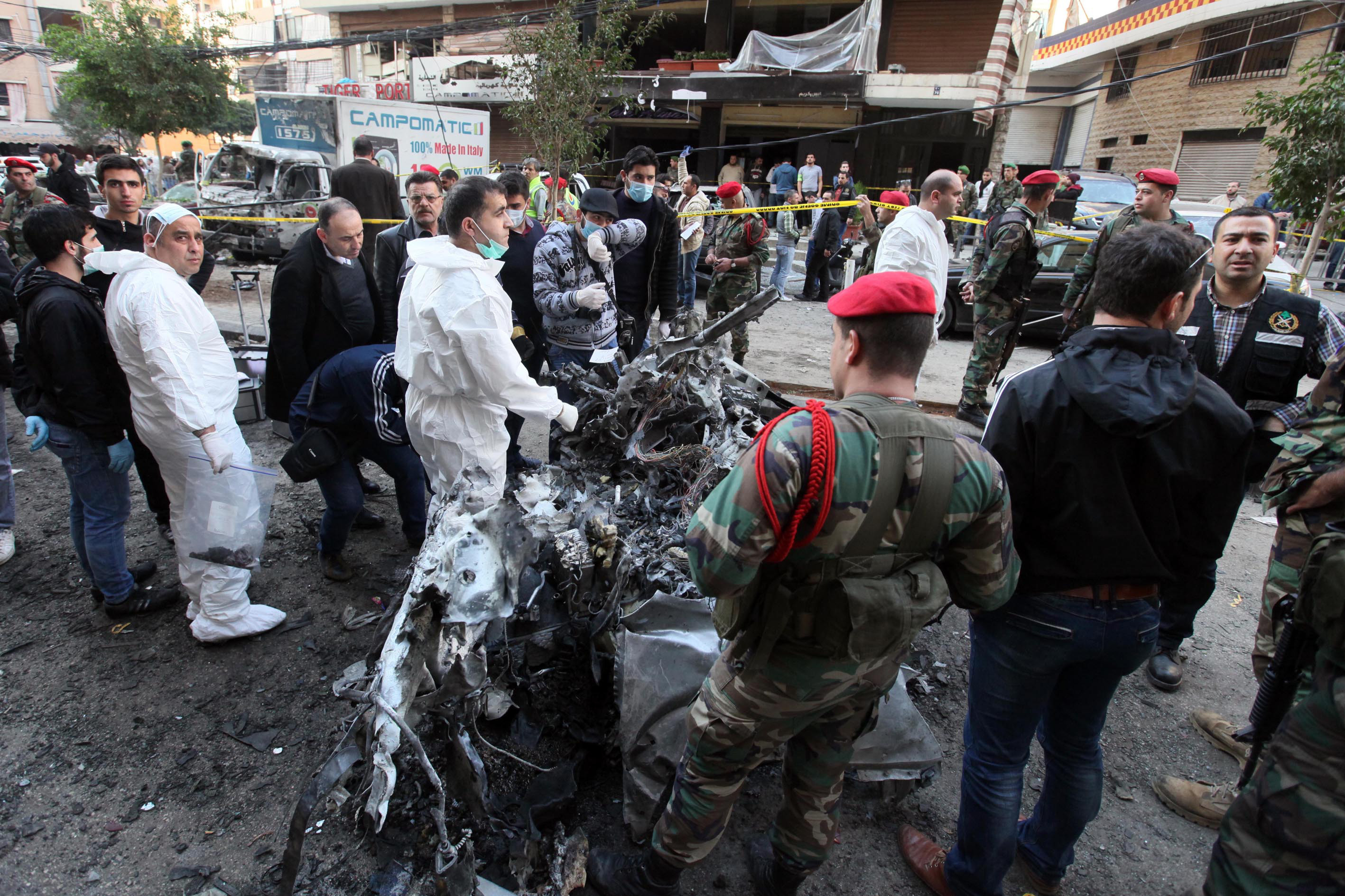 Criminal investigators operating at the scene of the explosion that targeted the area of Haret Hreik in Beirut's southern suburbs, a Hezbollah stronghold.