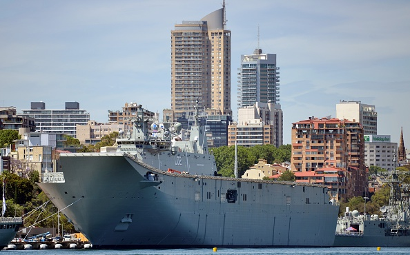 HMAS Canberra, the Royal Australian Navy's latest warship, is berthed at Garden Island naval base in Sydney on November 21, 2014. HMAS Canberra is the Royal Australian Navy's largest and most expensive warship and will be commissioned into service on November 28, 2014. AFP PHOTO/Peter PARKS (Photo credit should read PETER PARKS/AFP/Getty Images)