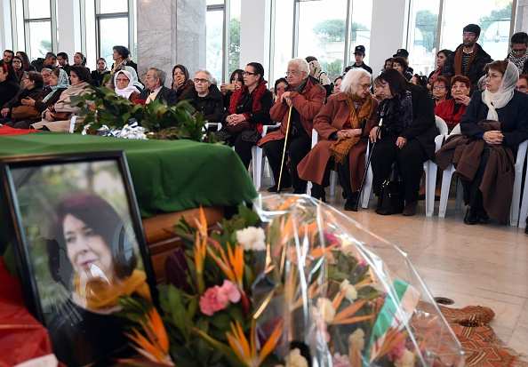 Mourners pay their respects to Assia Djebar (portrait) at the Palace of Culture in Algiers the day before her funeral in her native home town of Cherchell, a Berber coastal town west of Algiers on February 12, 2015. Djebar, who was an ardent defender of women's rights in her native Algeria, died the day before in a hospital in Paris. AFP PHOTO / FAROUK BATICHE (Photo credit should read FAROUK BATICHE/AFP/Getty Images)