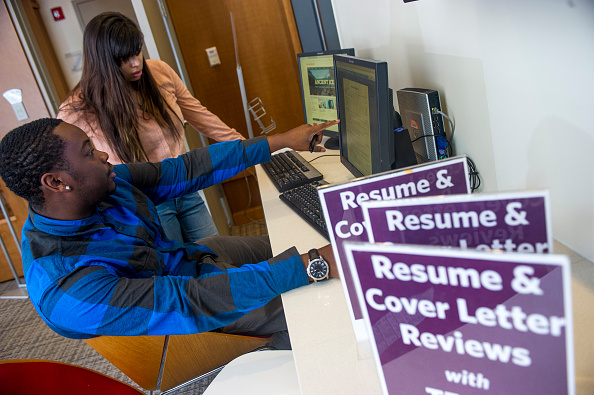 BOSTON, MA - FEBRUARY 4: Boston University senior, Rashid Nelson consults with senior Shilani Shah about her resume during a resume and cover letter review session at the Boston University Center for Career Development on February 4, 2015 in Boston, Massachusetts. Photo by Ann Hermes/The Christian Science Monitor