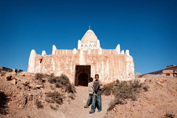 TINERHIR, DADES VALLEY, MOROCCO - 2012/12/26: Children playing in front of an ancient Moroccan holy shrine. (Photo by Raquel Maria Carbonell Pagola/LightRocket via Getty Images)