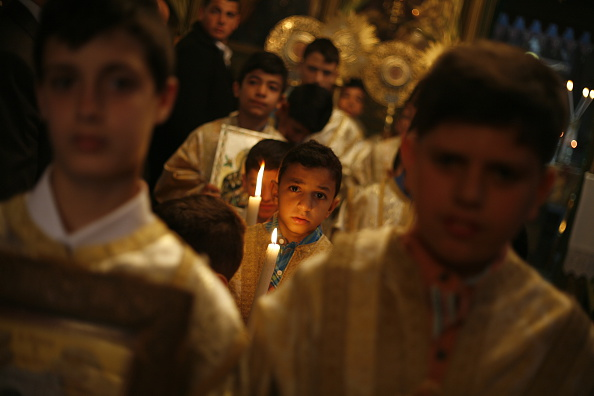 GAZA, GAZA STRIP, PALESTINE - 2015/04/08: Palestinian Christians at the St. Porphyrius Church in Gaza City celebrate Palm Sunday. Palm Sunday is a Christian movement feast that falls on the Sunday before Easter. The feast commemorates Jesus' triumphal entry into Jerusalem, an event mentioned in each of the four canonical Gospels. (Photo by Ahmed Hjazy/Pacific Press/LightRocket via Getty Images)