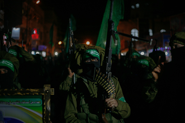NORTHERN GAZA, GAZA, BEIT LAHIA, PALESTINE - 2015/04/24: Palestinian Territory - Members of Ezzedeen al-Qassam brigades, the armed wing of Hamas movement, march during a rally in solidarity with Palestinian prisoners in Israeli jails, in Beit Lahia, in the northern Gaza Strip. (Photo by Ahmed Hjazy/Pacific Press/LightRocket via Getty Images)