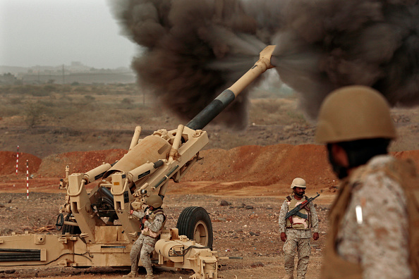 JIZAN, SAUDI ARABIA - APRIL 13:  Saudi military forces fire live projectile rounds into Yemen from positions inside Saudi territory. The rocket range is approximately 30 kilometers. Media members were shown the strength of the Royal Saudi Land Forces while on a tour of the region at Operation Decisive Storm near the month-long point, on April 13, 2015. The location of this area was close to Om Al-Turath. (Photo by Carolyn Cole/Los Angeles Times via Getty Images)
