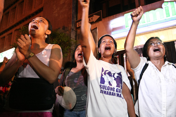 Protesters chanting songs as they celebrate the news that
