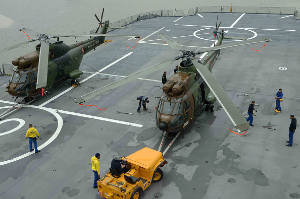 SHANGHAI, CHINA - MAY 09: (CHINA OUT) Helicopters are seen on the deck of French Mistral-class protection and command (BPC) ship Dixmude which is protected by frigate Aconit at Wusong Naval Port on May 9, 2015 in Shanghai, China. French Mistral-class protection and command (BPC) ship Dixmude and frigate Aconit started their seven-day visit to China. It's the first time that Mistral-class protection and command (BPC) ship Dixmude and frigate Aconit arrive in Shanghai and also the tenth visit that French navel vessels in China. (Photo by ChinaFotoPress/ChinaFotoPress via Getty Images)