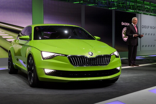 Winfried Vahland, chairman of Skoda Auto, presents the new Skoda Vision C concept car during a preview show by Volkswagen Group on March 3, 2014 on the eve of the press day of the Geneva Motor Show in Geneva. AFP PHOTO / FABRICE COFFRINI (Photo credit should read FABRICE COFFRINI/AFP/Getty Images)