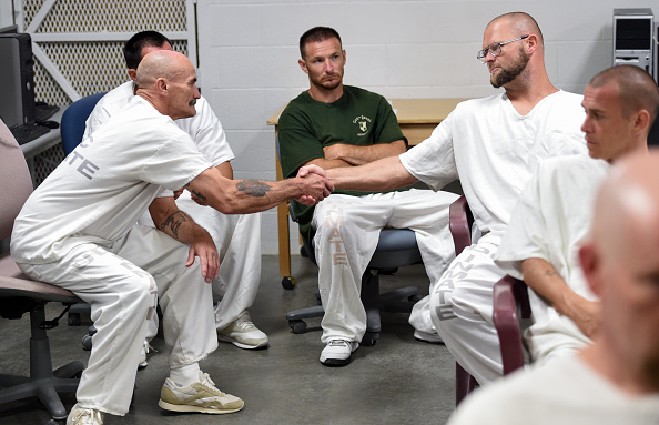 DRAPER, UT - JUNE, 19: Inmate  Michael Wardle (right) shakes the hand of Doug Wamsley  during a Addict II Athlete counseling program at the Utah State Prison - Promontory Facility on June 19, 2015 in Draper, UT. (Jonathan Newton / The Washington Post via Getty Images)