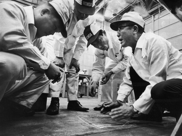 At a research and development facility, Japanese industrialist and founder of Honda corporation, Soichiro Honda (1906 - 1991) (right) talks with engineers about a solution to an automobible body noise problem, Tokyo, Japan, 1967. (Photo by Takeyoshi Tanuma/The LIFE Picture Collection/Getty Images)