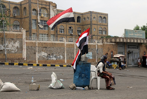 A fighter loyal to Yemen's exiled President Abedrabbo Mansour Hadi guards the gate leading to the governorate building in Yemen's third city Taez, after they seized it from rebel fighters on August 18, 2015. Pro-government and rebel forces have for months fought over Taez, seen as crucial gateway to the rebel-held capital Sanaa. AFP PHOTO / AHMAD AL-BASHA (Photo credit should read AHMAD AL-BASHA/AFP/Getty Images)