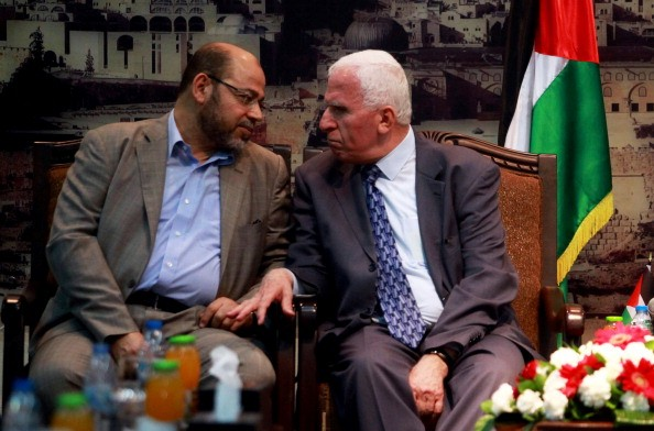 GAZA, GAZA STRIP, PALESTINE - 2014/04/22: Senior Hamas leader Moussa Abu Marzouk (L) and Azzam Al-Ahmed, a senior Fatah official talk during their meeting in Gaza City on April 22, 2014. The Palestine Liberation Organization (PLO) sent a delegation to Gaza on Tuesday to negotiate unity with militant group Hamas for the first time since their 2007 conflict, potentially boosting Fatah leader and Palestinian president Mahmoud Abbas's position. (Photo by Abed Deb/Pacific Press/LightRocket via Getty Images)