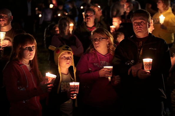 ROSEBURG, OREGON - OCTOBER 1: Denizens of Roseburg gather at a candlelight vigil for the victims of a shooting October 1, 2015 in Roseburg, Oregon. According to reports, 10 were killed and 20 injured when a gunman opened fire at Umpqua Community College in Roseburg, Oregon. (Photo by Michael Lloyd/Getty Images)