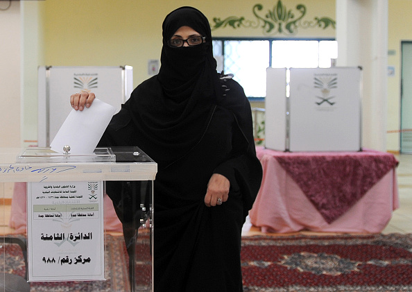 A Saudi woman casts her ballot at a polling station in the coastal city of Jeddah, on December 12, 2015, during municipal elections. Saudi women were allowed to vote in elections for the first time ever, in a tentative step towards easing widespread sex discrimination in the ultra-conservative Islamic kingdom. AFP PHOTO / STR / AFP / - (Photo credit should read -/AFP/Getty Images)