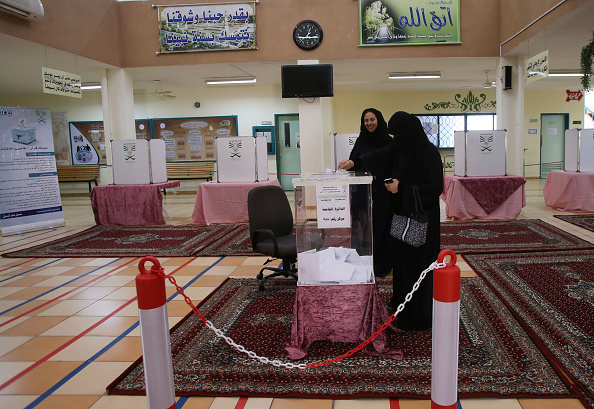JEDDAH, SAUDI ARABIA- DECEMBER 12: Saudi women cast their votes for the municipal elections at a polling station on December 12, 2015 in Jeddah, Saudi Arabia. Saudi Women are running the municipal council seats as candidates for the first time in the Kingdom's history and also be allowed for the first time to vote in a governmental election. The Municipal councils are the only government body in which Saudi Arabian citizens can elect representatives, so the vote is widely seen as a small but significant opening for women to play a more equal role in society. (Photo by Jordan Pix/ Getty Images)