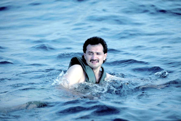 Billionaire investor Saudi Prince Alwaleed (Kingdom Holding Co.) swimming, sporting life vest, during outing on his yacht, Kingdom 5-KR, formerly owned by US real estate mogul Donald Trump. (Photo by Barry Iverson/The LIFE Images Collection/Getty Images)