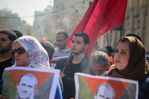 Palestinians of PFLP take part in a symbolic funeral for the
