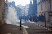 Riot police launched tear gas canisters against demonstrators of 'Nuit Debout' and trade unionists near the bureau of the Socialist Party in Toulouse. They denounce the use by Prime Minister Manuel Valls the use of the article 49.3 which permits to adopt a bill without vote in the assembly.Toulouse. France. May 10th 2016. Several thousands sympathizers of the 'Nuit Debout' (Up All Night) movement and trade unionists reacted with an unauthorized demonstration after the announcement of the use by Socialist Prime Minister Manuel Valls of the article 49.3 of the Constitution to pass the El-Khomri bill on labour reforms with nor vote nor debate in the Parliament.All 'Nuit Debout' movements in France reacted with spontaneous demonstrations. Clashes took place in Paris, Toulouse, Rennes, Marseille, etc.In Toulouse, two people were injured. (Photo by Alain Pitton/NurPhoto)