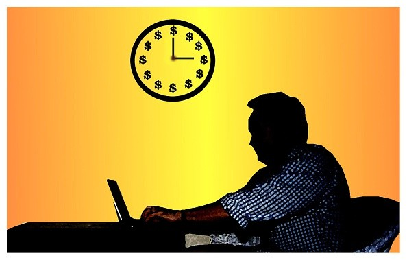 (AUSTRALIA & NEW ZEALAND OUT) A man sits at his desk working on his laptop beneath a wall clock, 13 February 2003. AFR Photo-Illustration by MICHEL O'SULLIVAN (Photo by Fairfax Media via Getty Images)