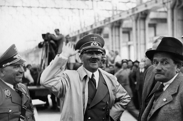 (GERMANY OUT) Adolf Hitler visiting the Volkswagen factory in Fallersleben performing the Hitler salute; left: Reichsleiter Robert Ley - 1938- Photographer: Presse-Illustrationen Heinrich Hoffmann- Published by: 'Die Braune Post' 26/1939Vintage property of ullstein bild (Photo by Heinrich Hoffmann/ullstein bild via Getty Images)