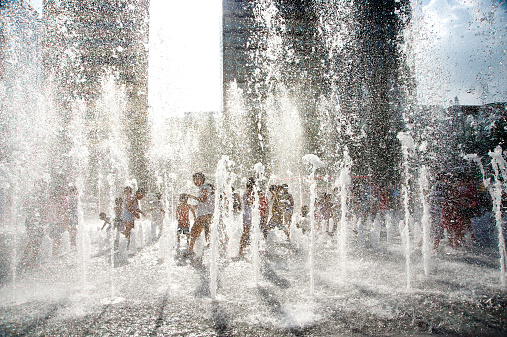 People cooling off in a fountain on Gwanghwamun Gate plaza.