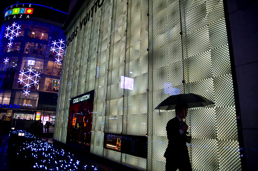 Holiday lights at night brighten the Lotte Department store and hotel.