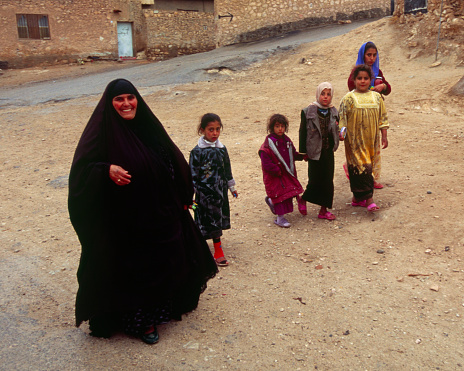 A Smiling Mother and Her Children Approach a Squad of US Marines During a Combat Patrol in Barwana, Iraq