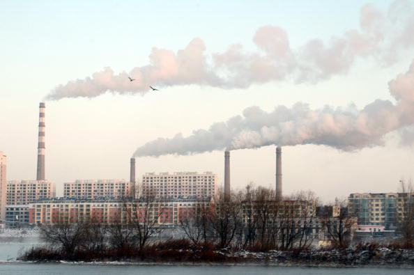 JILIN CITY, CHINA - NOVEMBER 19: Smoke billows out of chimneys in downtown Jilin city in northeast China's Jilin province Thursday November 19, 2009. China is the world's biggest greenhouse gas emitter. (Photo by Feature China / Barcroft Media / Getty Images)
