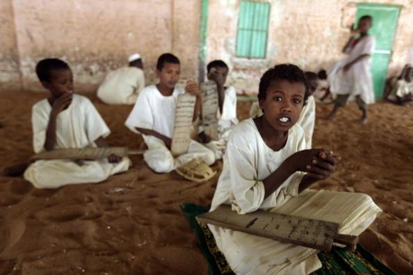 Sudanese Sufi students recite verses of
