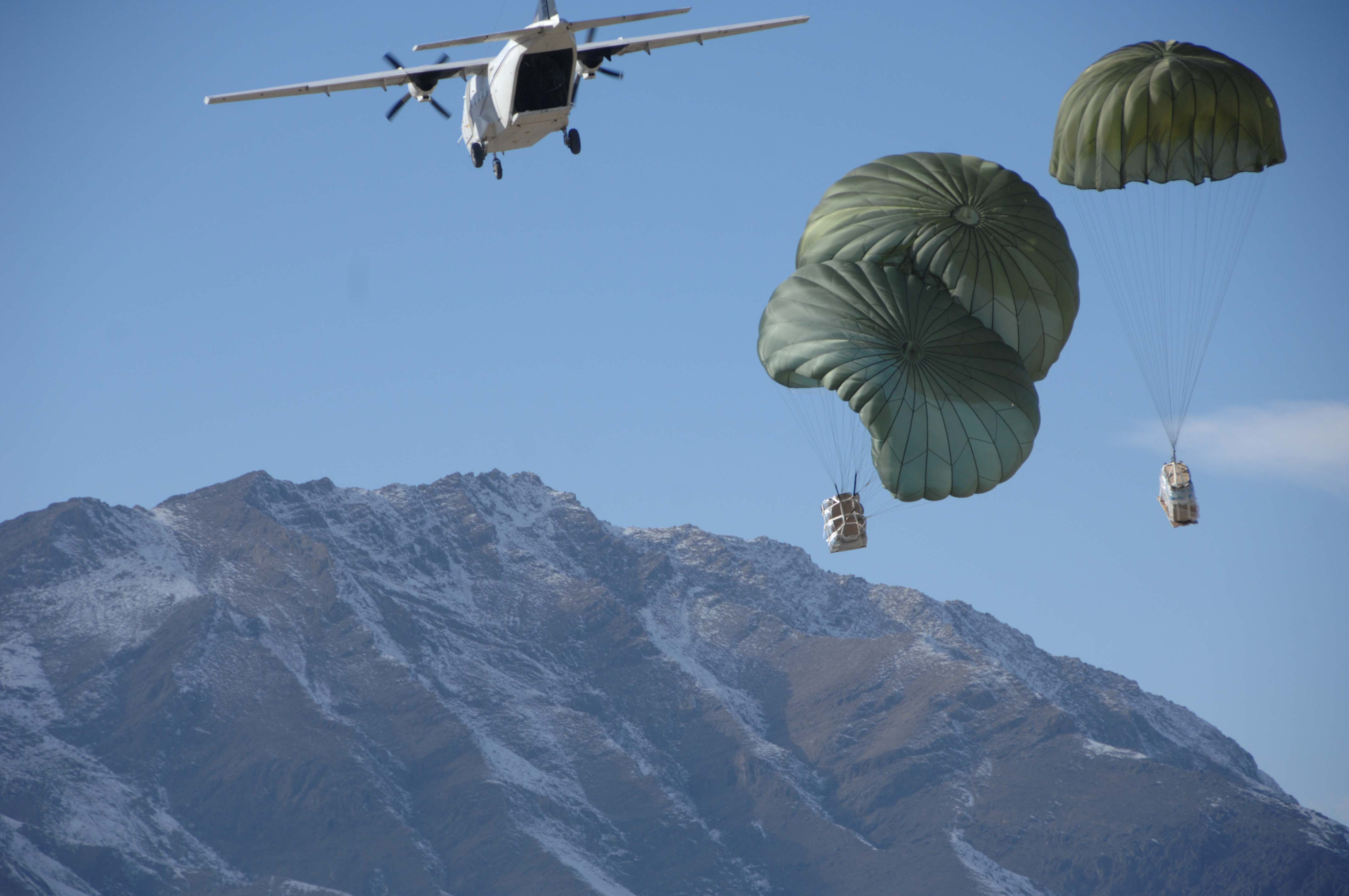 In the vacinity of Kabul, Afghanistan U.S. Coalition forces test a new delivery system for getting Class I, III, and V items to troops on the ground for extended missions; via smaller parachute bundles. U.S. Army photo by SPC John P. Ledington