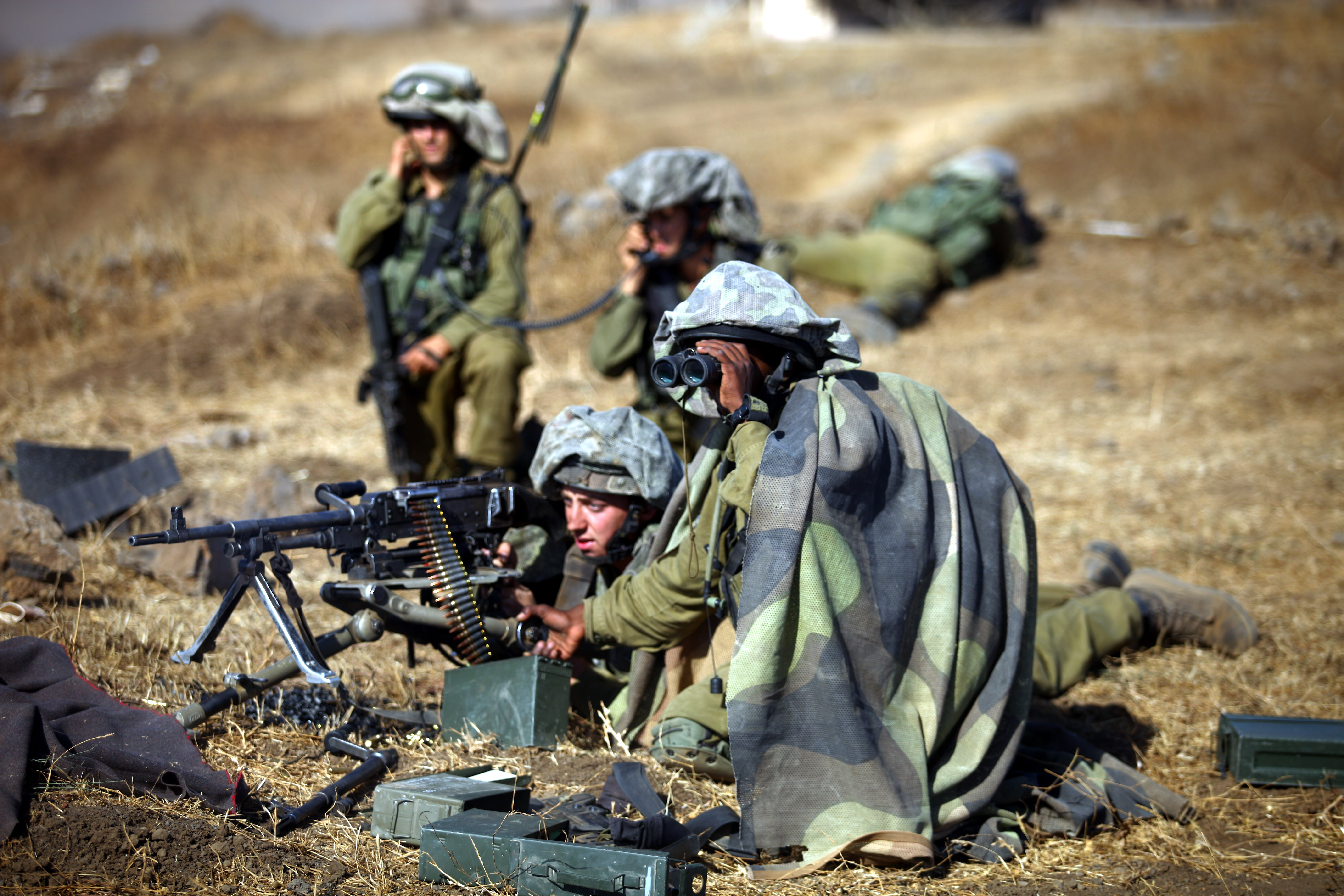 israeli soldier cover with camouflage equipment during a military exercise in the Golan Heights norhten Israel on 21 August 2012