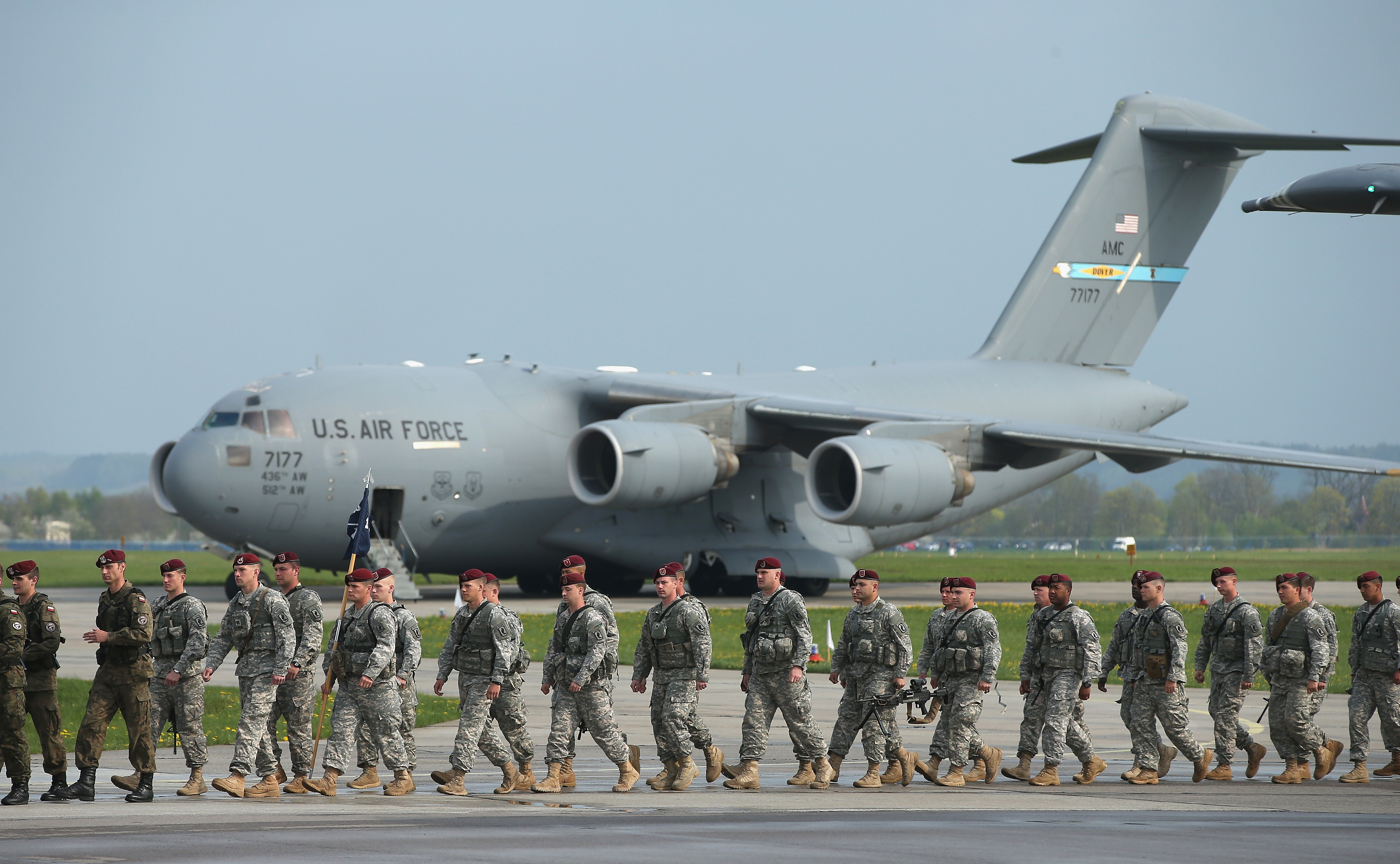 SWIDWIN, POLAND - APRIL 23: Members of the U.S. Army 173rd Airborne Brigade disembark upon their arrival by plane at a Polish air force base on April 23, 2014 in Swidwin, Poland. Approximately 150 U.S. troops, as well as another 450 destined for the three Baltic states in coming days, will participate in bilateral military exercises over the coming weeks in a sign of commitment among NATO members. Tensions are rising in eastern Ukraine between Russian separatists and Ukrainian authorities and NATO is seeking to reassure its own members located close to Russia. (Photo by Sean Gallup/Getty Images)