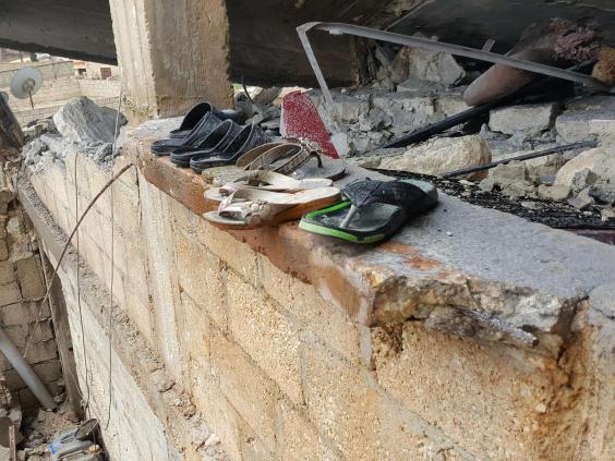 بقايا منزل عائلة الخاطر بعد القصف التركي، مصدر الصورة: الإندبندنت